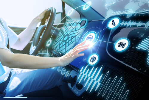 over-the-air-updates-futurisitc-car-interior-person-interacting-with-car-technology